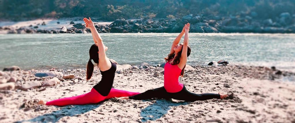 Image of 2 girls doing yoga in india